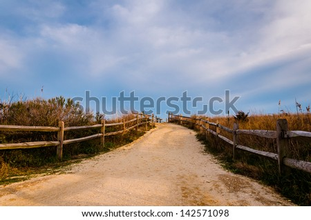 Path over sand dunes to the beach, Cape May, New Jersey. - stock photo