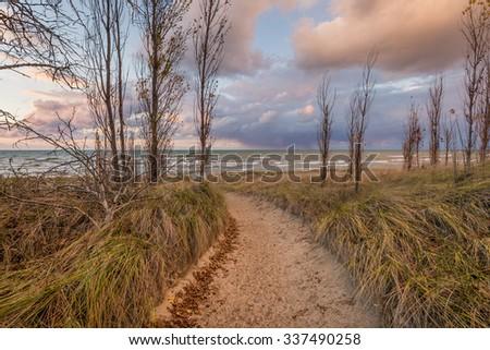 Path through a sand dune to a Lake Huron beach - Grand Bend, Ontario, Canada - stock photo