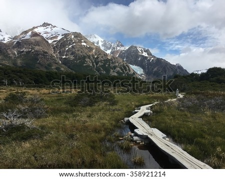 Path through a wetland in the Andes Mountains - stock photo