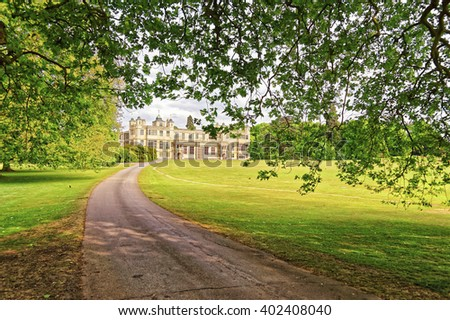 Path to Audley End House in Essex in England. It is a medieval county house. Now it is under protection of the English Heritage. - stock photo