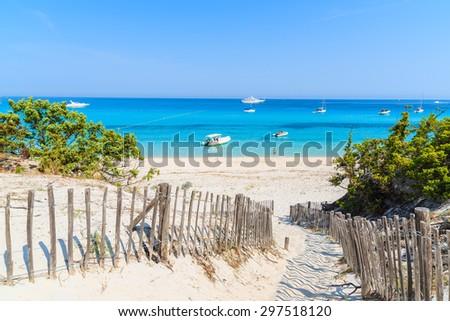 Path to Saleccia beach with azure sea water near Saint Florent, Corsica island, France - stock photo