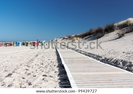 Path to the beach on Langeoog with beach chairs and the North Sea in the background
