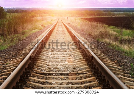 Path to the sun. Scene of railroad in beams of sunset.  - stock photo