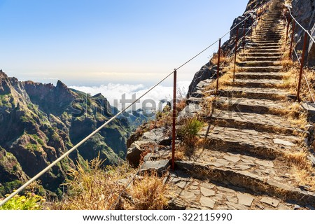 Path with steps and handrails in the mountains, Portugal, Madeira - stock photo