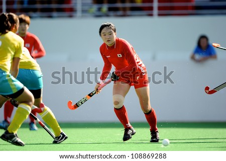 PATHUM THANI,THAILAND-JULY 3:Hong Jiseon (no.7 Red) of Korea fights for the ball during the Womens Junior AsiaCup Korea and Kazakhstan at QueenSirikit Stadium on July3,2012 in PathumThani,Thailand.
