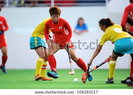 PATHUM THANI,THAILAND-JULY 3:Nam So Ri ( Red) of Korea fights for the ball during the Women�s Junior AsiaCup Korea and Kazakhstan at QueenSirikit Stadium on July3,2012 in PathumThani,Thailand.