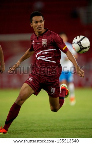 PATHUM THANI,THAILAND-JULY 21:Paitoon Nontadee (red) of  InseePolice UTD in action during Thai Premier League between InseePolice UTD.and TOT SC.at Thammasat Stadium on July,2013 in Thailand - stock photo