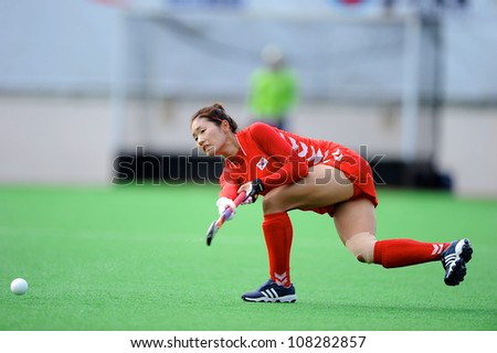 PATHUM THANI,THAILAND-JULY 3:Seo Jung Eun (Red) of Korea hits the ball during the Women�s Junior AsiaCup Korea and Kazakhstan at QueenSirikit Stadium on July3,2012 in PathumThani,Thailand.