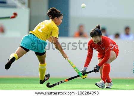 PATHUM THANI,THAILAND-JULY 3:Urmanova Guzal no.2 of Kazakhstan fights for the ball during the Women�s Junior AsiaCup Korea and Kazakhstan at QueenSirikit Stadium on July3,2012 in PathumThani,Thailand.