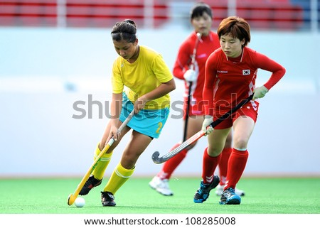 PATHUM THANI,THAILAND-JULY 3:Yefremova Kristina(Y)of Kazakhstan handles the ball during the Women�s Junior AsiaCup Korea and Kazakhstan at QueenSirikit Stadium on July3,2012 in PathumThani,Thailand.