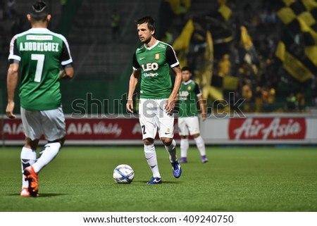 PATHUM THANI,THAILAND-MAR 6:Darko Tasevski in action during Thai Premier League 2016 between Bangkok Glass FC.and Osotspa M-150 Samutprakan FC.at Leo Stadium on March 6,2016 in PathumThani,Thailand - stock photo
