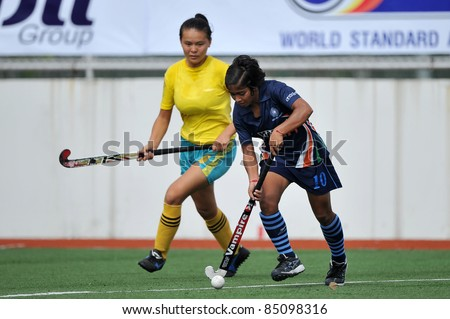 PATHUM THANI THAILAND-SEPTEMBER 16:GoYal neha(B) during in ptt grils asia cup 2011(U18),Ind Vs Kaz at Commemoration Of Queen Sirikit Sports Stadium on Sep16,2011 in Pathum Thani Thai