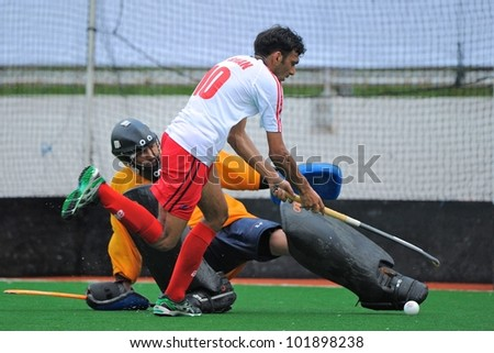 PATHUMTHANI THAILAND-APRIL17:Alamgir Khan (W)of HKG in action during The Fourth men's ptt AHF cup betaween HKG(W) and KAZ(R) at Queen Sirikit Sports Stadium on April 17,2012 in Pathumthani Thailand