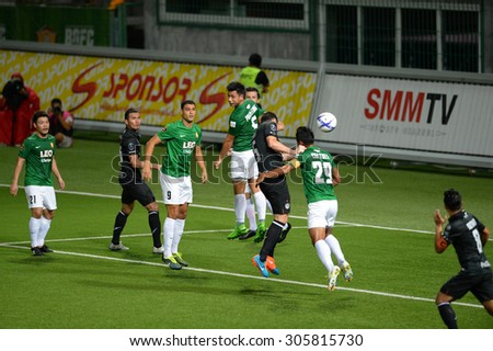 PATHUMTHANI, THAILAND- AUG12: Andres Tunez #5 of BuriramUtd shooting the ball in action during Thai Premier League 2015 between BGFC and BuriramUtd at Leo Stadium on August 12, 2015 in Thailand. - stock photo