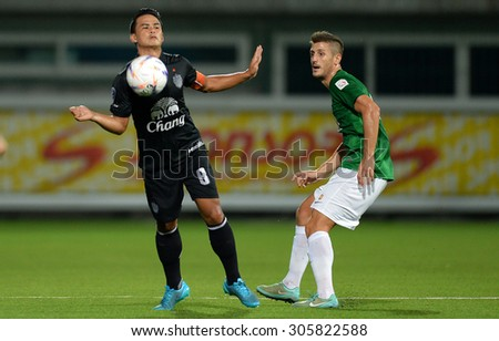 PATHUMTHANI, THAILAND- AUG12: Suchao Nuchnoom(L) of BuriramUtd in action during Thai Premier League 2015 between BGFC and BuriramUtd at Leo Stadium on August 12, 2015 in Thailand. - stock photo