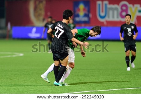 PATHUMTHANI,THAILAND-FEB2015:Darko Tasevski(g) of BGFC in action during geam AFC Champions League 2015 : BangkokGlassFC(Th) 3-0 JohorDarulTakzim(My) at LeoStadium on February 10, 2015 in Thailand - stock photo