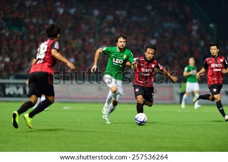 PATHUMTHANI,THAILAND-FEB 28:Darko Tasevski(g) of BGFC in action during geam Thai premier League 2015 between Bangkok Glass FC and Muangthong UTD at LeoStadium on February 28, 2015 in Thailand - stock photo