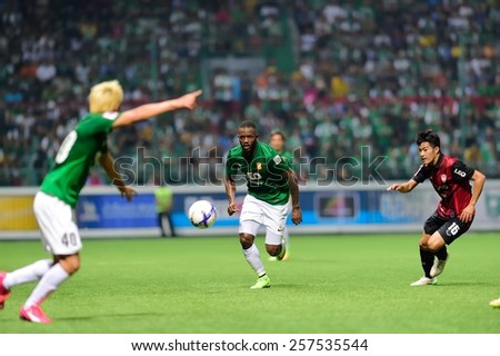 PATHUMTHANI,THAILAND-FEB 28:Lazarus Kaimbi(g) of BGFC in action during geam Thai premier League 2015 between Bangkok Glass FC and Muangthong UTD at LeoStadium on February 28, 2015 in Thailand - stock photo
