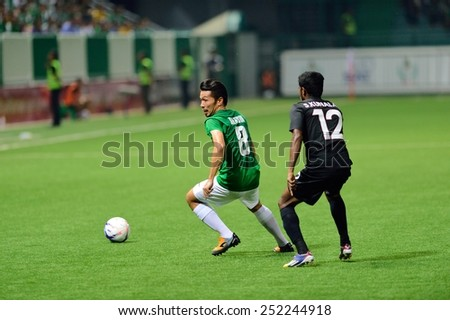 PATHUMTHANI,THAILAND-FEB2015:Narong Jansawek(g) of BGFC in action during geam AFC Champions League 2015 : BangkokGlassFC(Th) 3-0 JohorDarulTakzim(My) at LeoStadium on February 10, 2015 in Thailand - stock photo
