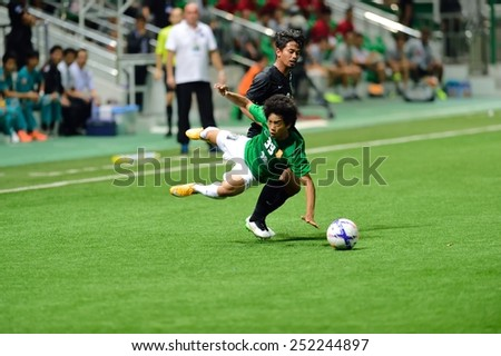 PATHUMTHANI,THAILAND-FEB2015:Tanasith Siripala(g) of BGFC in action during geam AFC Champions League 2015 : BangkokGlassFC(Th) 3-0 JohorDarulTakzim(My) at LeoStadium on February 10, 2015 in Thailand