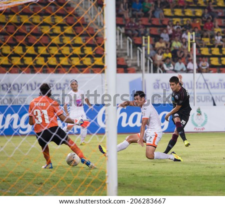 PATHUMTHANI THAILAND- JULY 19:S.Suarez(black) during Thai Premier League (TPL) between Police United(black) vs Sisaket F.C.(white) on July 19, 2014  at Thammasat Stadium in Pathumthani Thailand
