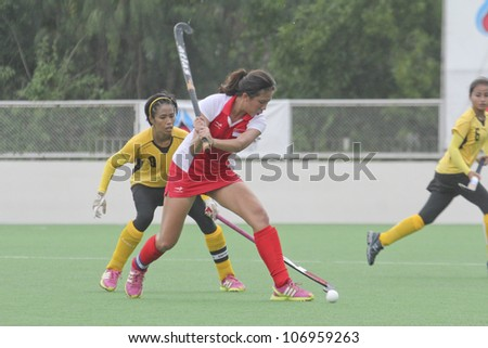 PATHUMTHANI,THAILAND - JUNE 27 : Unidentified player in Women's Junior PTT Asia Cup 2012 Between Malaysia (Y) VS Singapore (R) on June 27, 2012 in Pathumthani,Thailand