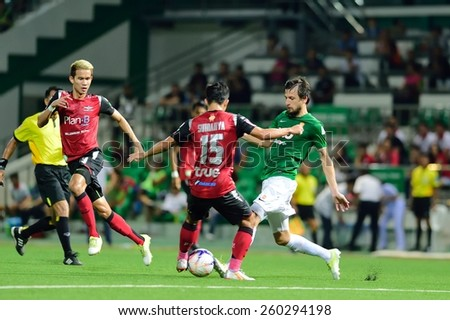 PATHUMTHANI,THAILAND, MARCH 2015 :Darko Tasevski(G) of BGFC in action during geam Thai premier League 2015 between Bangkok Glass FC and Bangkok UTD at LeoStadium on MARCH 11, 2015 in Thailand - stock photo