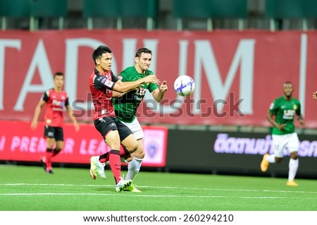 PATHUMTHANI,THAILAND, MARCH 2015:Leandro De Oliveira Da Luz(G) of BGFC in action during geam Thai premier League 2015 between BangkokGlassFC and Bangkok UTD at LeoStadium on MARCH 11, 2015 in Thailand - stock photo
