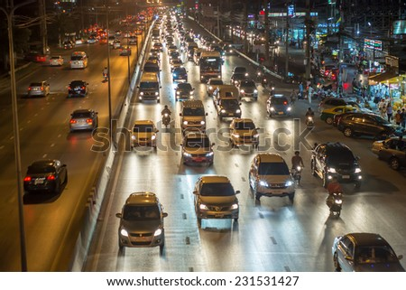 Pathumthani,Thailand-November 13,2014 : Night busy traffic in motion blur car at Ransit road in Pathumthani , Thailand.