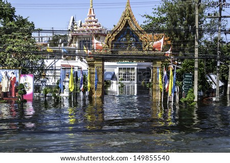 PATHUMTHANI, THAILAND - OCTOBER 30: Heavy flooding from monsoon rain in north Thailand arriving in Bangkok suburbs on October 30, 2011 in Pathumthani, Thailand. Faces its worst flooding in 50 years. - stock photo