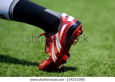 PATHUMTHANI,THAILAND SEP14 :Detail of a player boots during Thai premier League 2013 between Bangkok Glass FC and Pattaya United at LeoStadium on september14, 2013 in Thailand  - stock photo