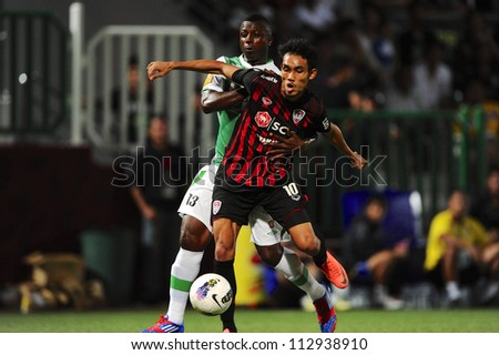 PATHUMTHANI,THAILAND-2 SEPTEMBER:Teerasil Dangda (red) of SCG Muangthong Utd in action during Thai Premier League between Bangkok Glass.and SCG Muangthong Utd.at Leo Stadium on Sep 2,2012 in Thailand