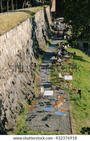 Pathway along the wall of Akershus Fortress, a medieval castle, part of which is now a public park, in Oslo (Norway)