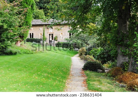Pathway and Lawn in a Peaceful Green Garden  - stock photo