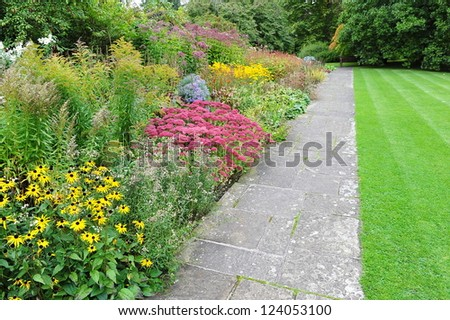 Pathway in a Beautiful Tranquil Public Park - stock photo