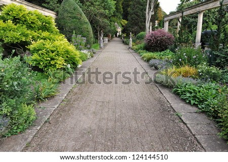 Pathway in an English Formal Garden - stock photo