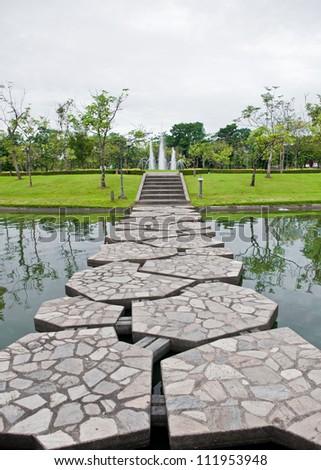 Pathway in tropical garden of Thailand. - stock photo