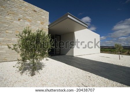 Pathway leading up to modern building - stock photo