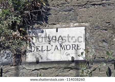 "Pathway of love, in Italian ""Via dell'Amore"", famous lover road between Riomaggiore and Manarola in Cinque Terre, Italy - stock photo"