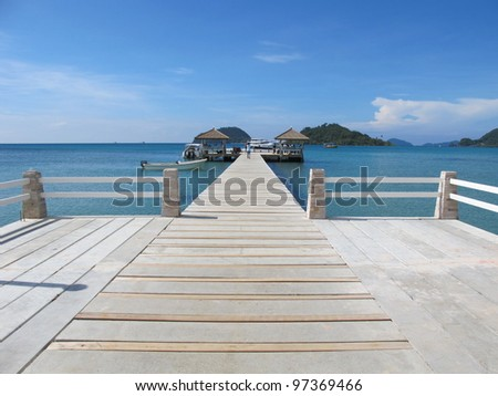 Pathway on the wood pier to the sea
