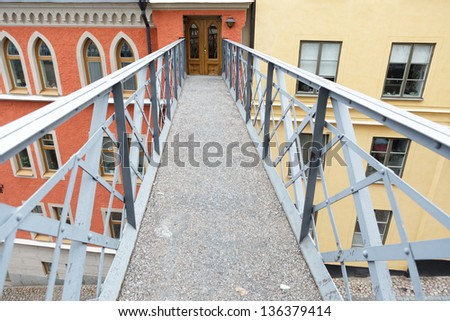 Pathway over road Mariaberget, old part of Stockholm - stock photo
