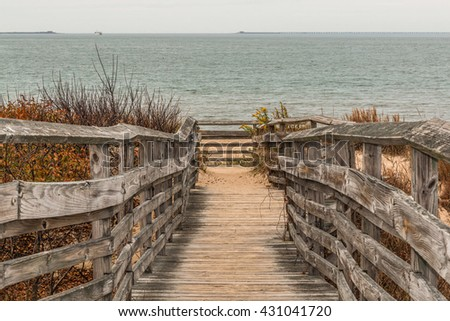 Pathway to beach with ocean background at First Landing State Park in Virginia Beach, Virginia.   - stock photo