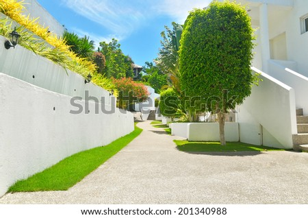 Pathway to tropical holiday villas - stock photo