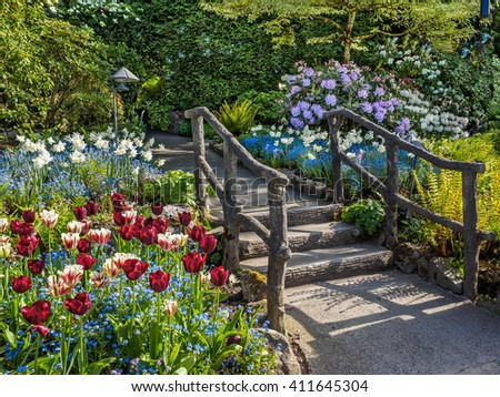 Pathway with steps and wooden rails in a spring garden