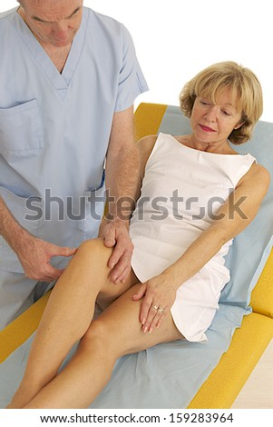 patient and therapist - knees pain - orthopedic massage  - stock photo