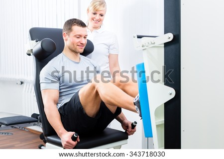 Patient at the physiotherapy doing physical exercises using leg press in sport remobilization - stock photo