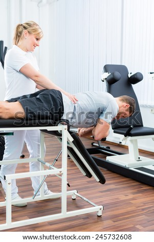 Patient at the physiotherapy doing physical exercises with therapist with sport doctor - stock photo