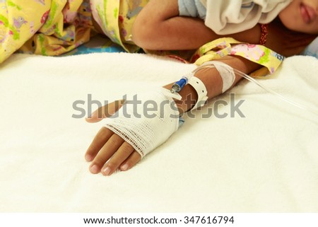 Patient child in hospital bed with saline intravenous (iv).Pediatric care unit in hospital. - stock photo