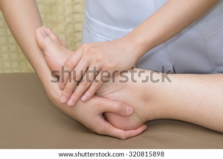 patient  doing physical exercises with physical therapist ,at stroke clinic - stock photo