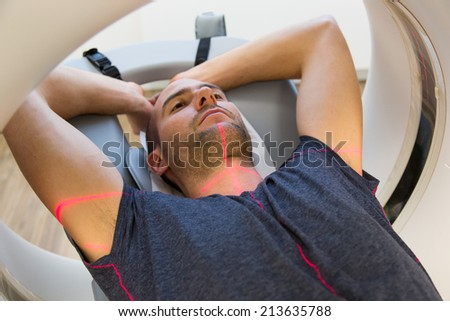 Patient examined in x-ray computed tomography CT at radiology clinic - stock photo
